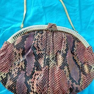 Judith Leiber python skin clutch with gold trim